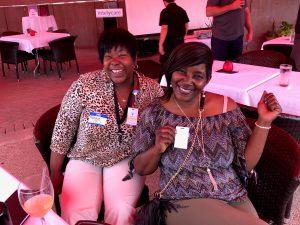 IntelyPro Nurses show off their badges at a nurse week event