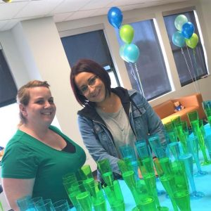 Two IntelyCare employees celebrating during a company party