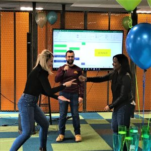 Employees at IntelyCare playing rock paper scissor for a company party